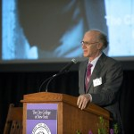 Peter Salk speaks at the 2014 CCNY centenary symposium. Image courtesy of CCNY.
